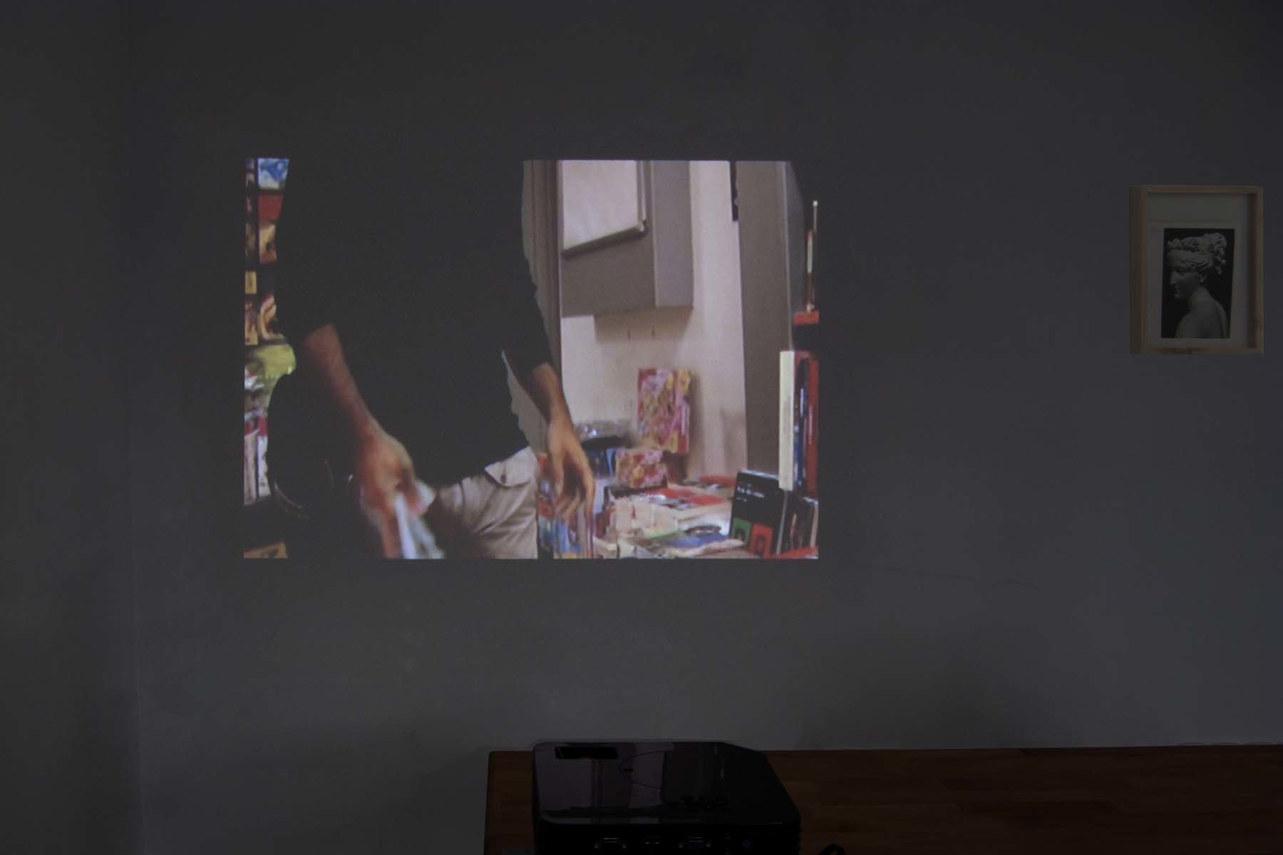 C. Chironi, DK, 2009, video, stolen book page, frame