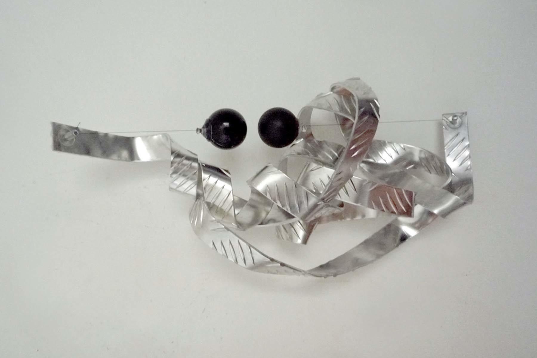 L. Pozzi, String #07, 2010, alluminium, magnet, nylon, ping pong balls, suction cup, 60 x 40 x 20 cm