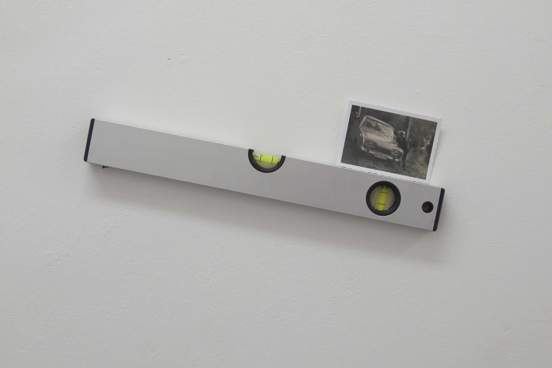 N. Genovese, Sonic or liquid, I don't know, 2010, digital print and spirit level, 39 x 17 x 2 cm